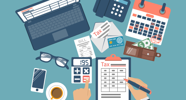 Cluttered desk filled with tools to help with taxes