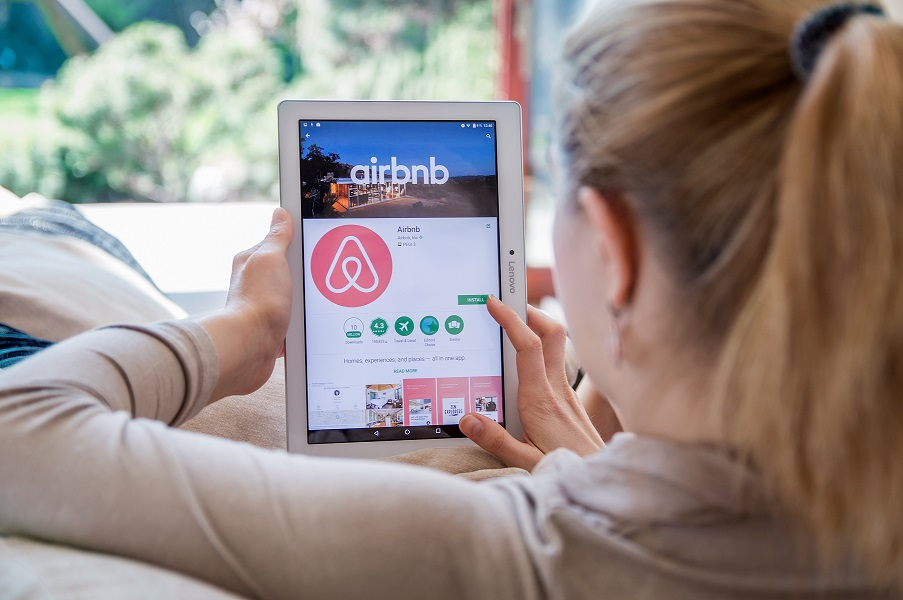 Woman scrolling on airbnb