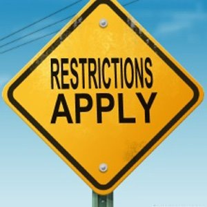 Restrictions apply sign