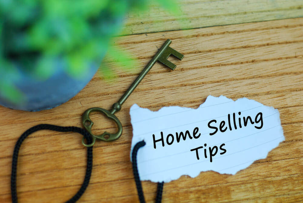 home selling tips with a key on a twine