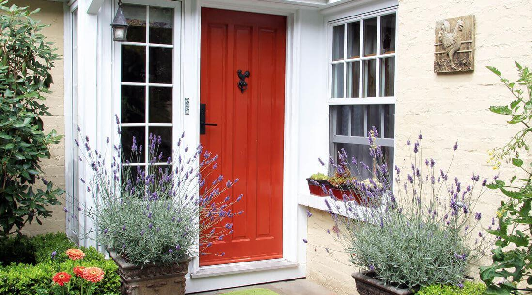 Front entrance with a red door
