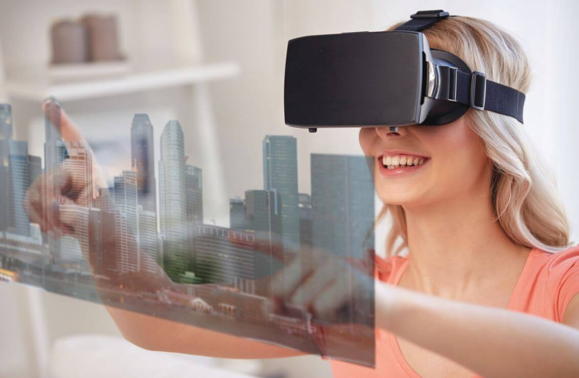 A lady using a 3d virtual image to view housing