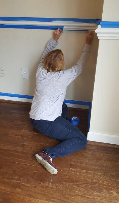 A realtor doing a voluntary house painting